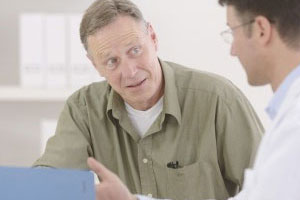 Mature Man being consulted by a Physician