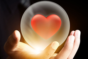 Picture of Heart in a Crystal Ball being held by a hand.