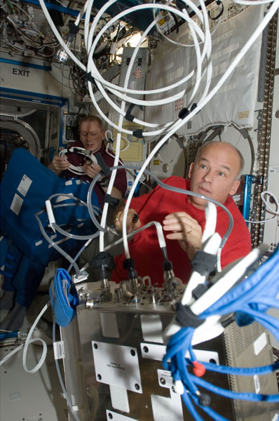 NASA Copyright 2009,  ISS021-E-006177 (14 Oct. 2009) --- NASA astronaut Jeffrey Williams, Expedition 21 flight engineer, works with the Portable Pulmonary Function System (PPFS) in the Destiny laboratory of the International Space Station. European Space Agency astronaut Frank De Winne, commander, works in the background.